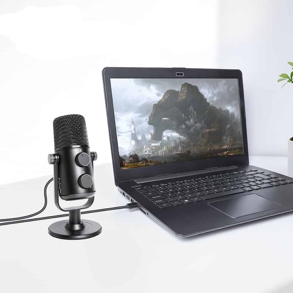 A laptop computer sitting on top of a table